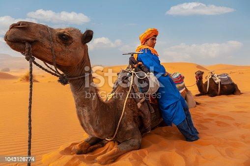 Berber man at sunset in the desert of Merzouga, Morocco