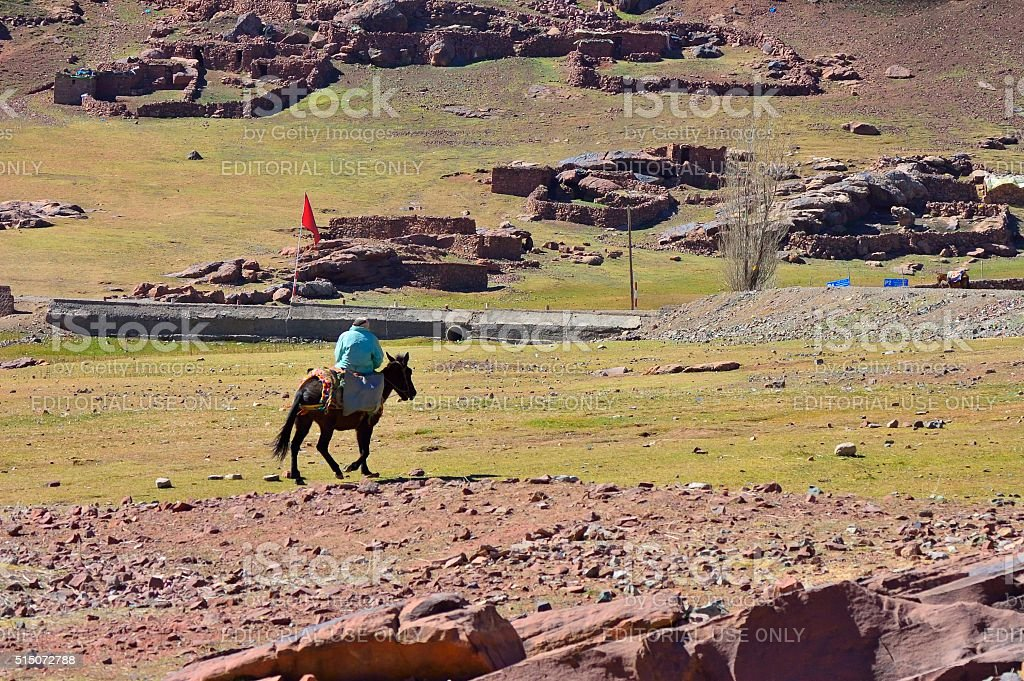 Berber Tribesman Riding Horse stock photo