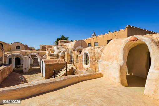 Ksar Haddada or Ksar Hadada is a Berber village of about 1,500 inhabitants in Tataouine Governorate in southern Tunisia. Quarrystones and clay built Ksar consisting superposed from a closed courtyard with two floors and vaulted storage chambers (ghorfas). The chambers were used as storerooms for stocks (cereals, oil, dried beans, lentils, dates, etc.) and other belongings kind (household and work tools, weapons) for the semi-nomadic (transhumance) families living situation.