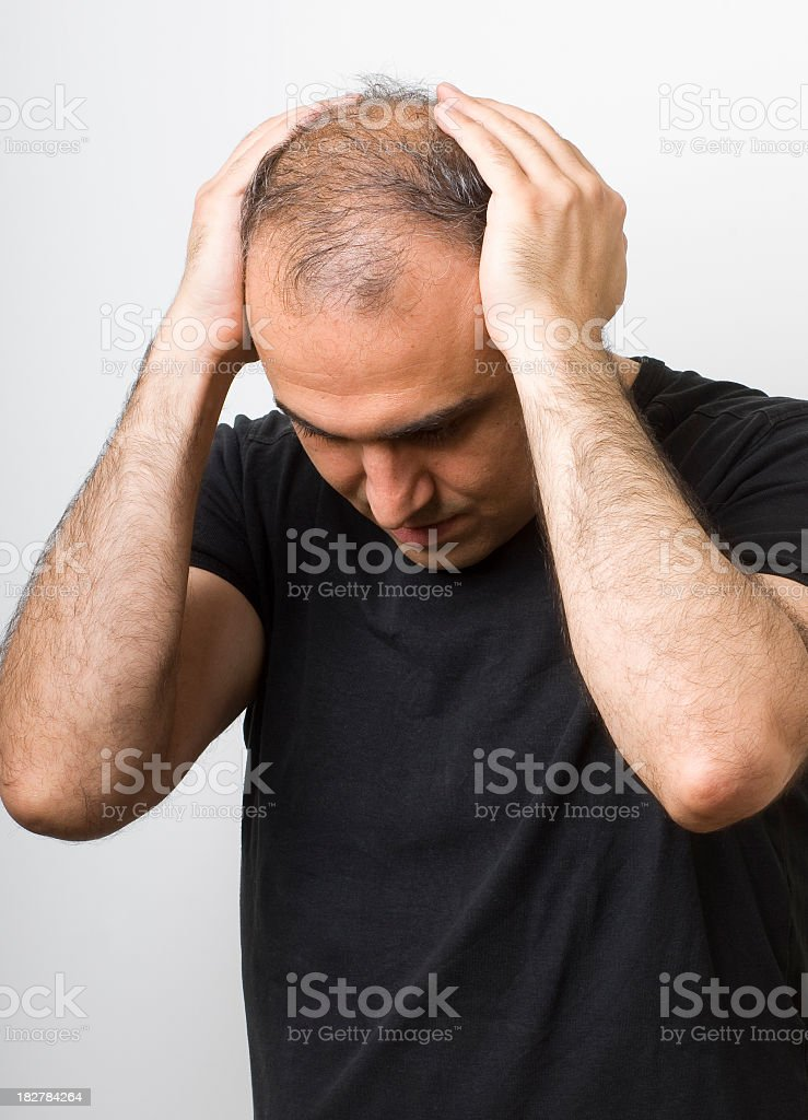Bereaved man grieving with a black shirt stock photo