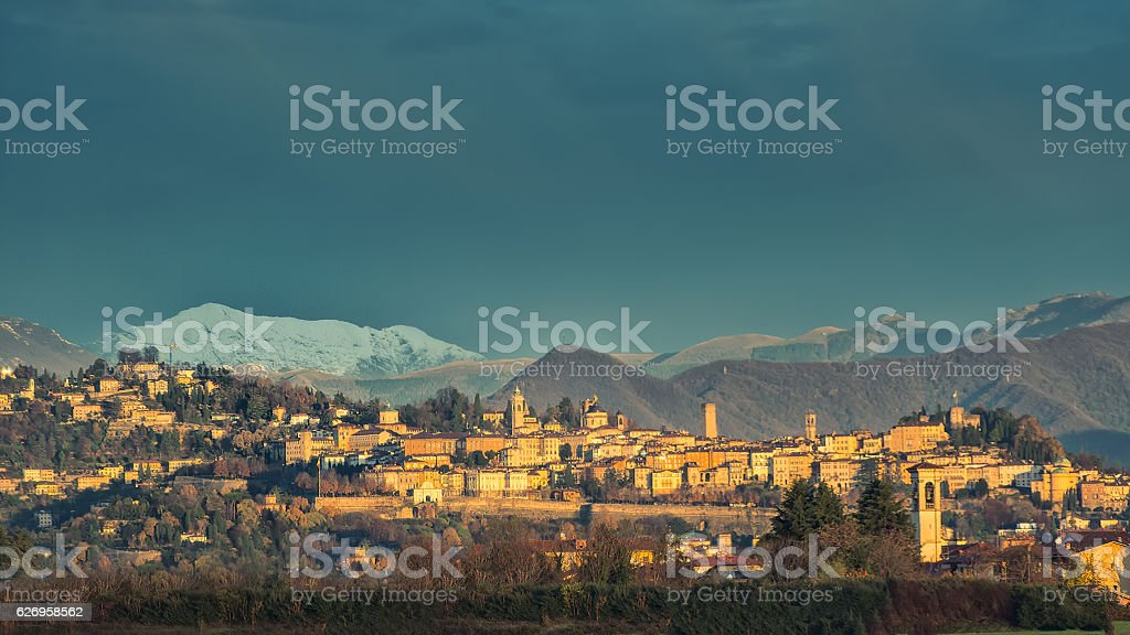 Bergamo Alta  with snow in the mountains stock photo