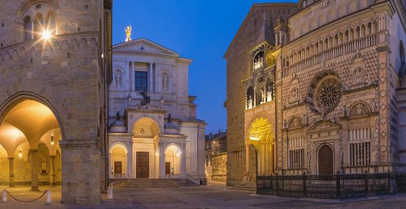 Bergamo - Colleoni chapel, Duomo and cathedral Santa Maria Maggiore in upper town at dusk.