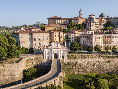 Bergamo, Italy. Drone aerial view of the old gate San Giacomo and historical building. The Old town. One of the beautiful city in Italy