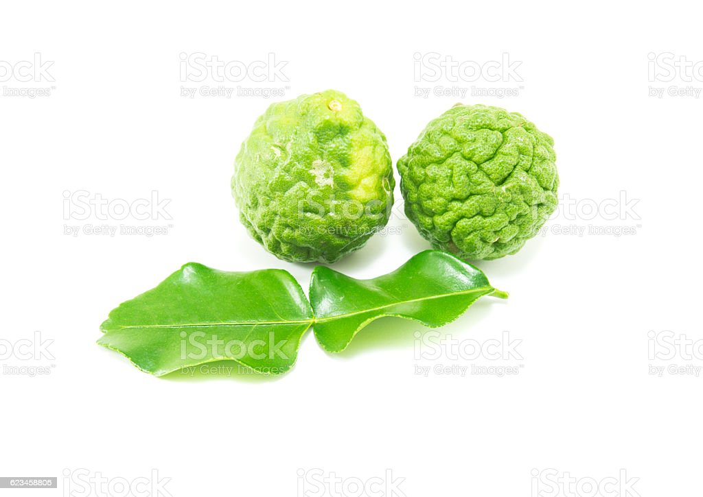 Bergamot and green leafs on white background stock photo