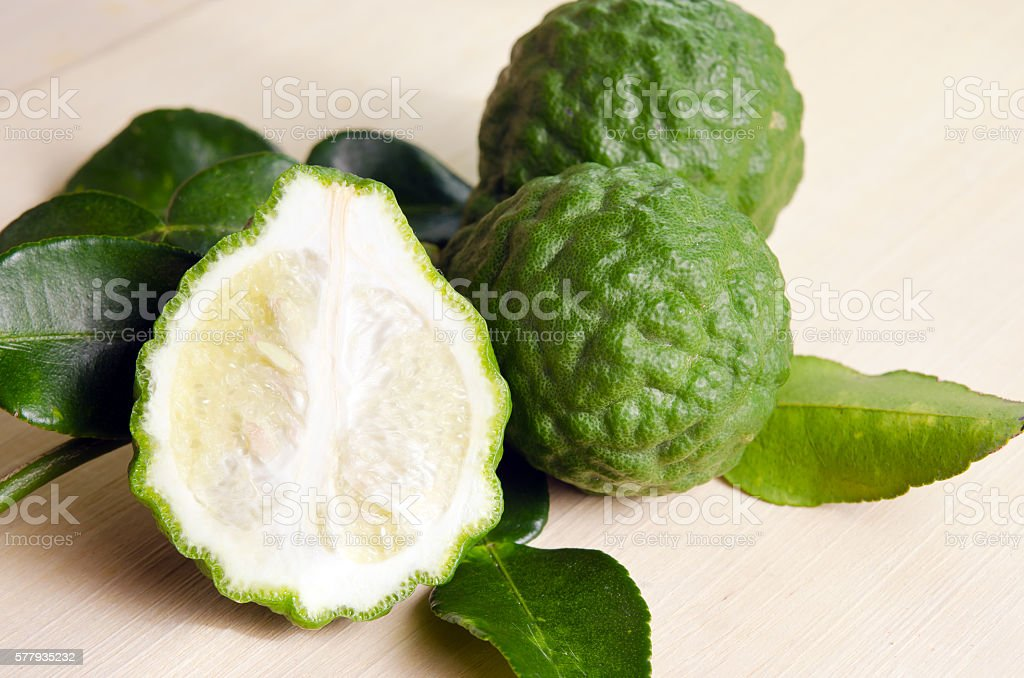 Bergamot fruit with leaf on wooden board stock photo
