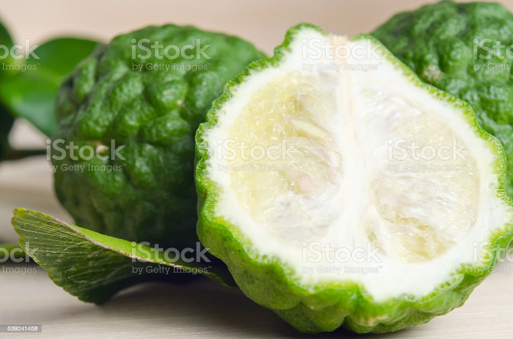 Bergamots fruit with leaf on wooden board royalty-free stock photo