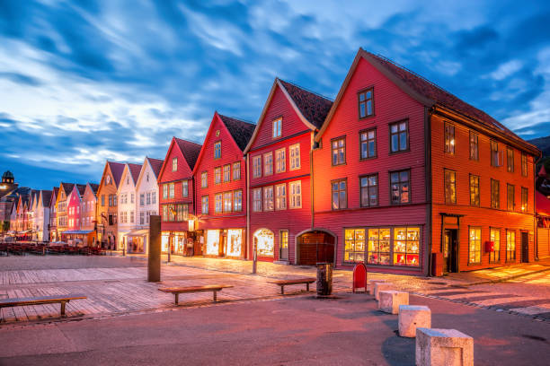 Bergen street with old houses at night in Norway, UNESCO World Heritage Site stock photo