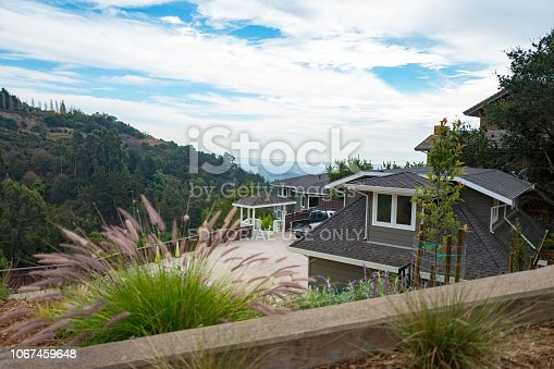 Berkeley, California, United States - October 02, 2018:  Aerial view of the Berkeley Hills and a modern home overlooking the San Francisco Bay Area in Berkeley, California; the area is known for upscale and architecturally unique homes situated on the area's steep hillsides, October 2, 2018