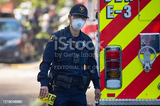 Berkeley, California, USA - April 14, 2020: Police respond to a residential fire on Blake Street in Berkeley, California during the state ordered shelter-at-home for COVID-19.