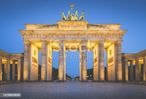 Classic view of famous Brandenburger Tor (Brandenburg Gate), one of the best-known landmarks and national symbols of Germany, during blue hour with retro vintage Instagram VSCO filter, Berlin, Germany