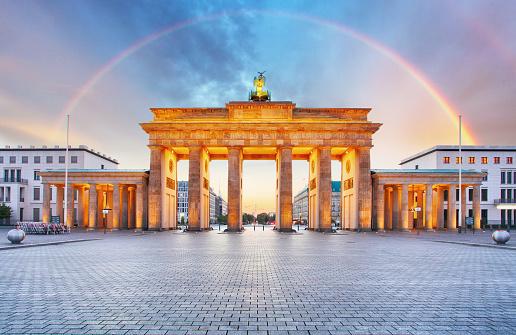 Berlin Brandenburger gate with rainbow.