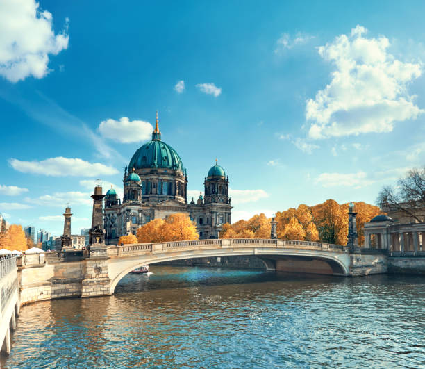 Berlin Cathedral with a bridge over Spree river in Autumn Berlin Cathedral with a bridge over Spree river in Autumn, panoramic toned image berlin stock pictures, royalty-free photos & images