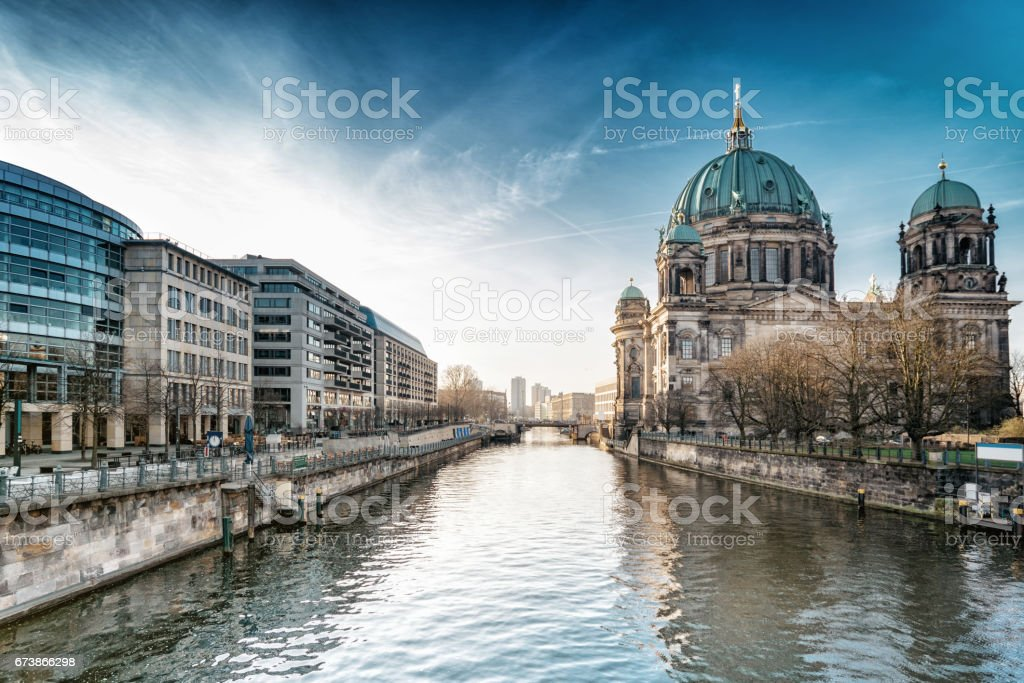 Berlin Cathedral with reflection in river spree at morning hour stock photo