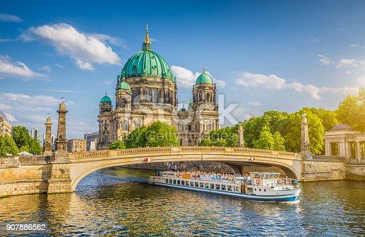 istock Berlin Cathedral with ship on Spree river at sunset, Berlin, Germany 907886562