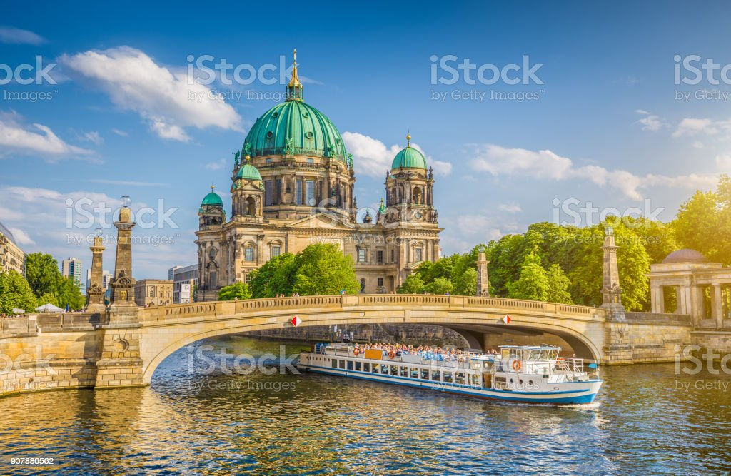 Berlin Cathedral with ship on Spree river at sunset, Berlin, Germany stock photo