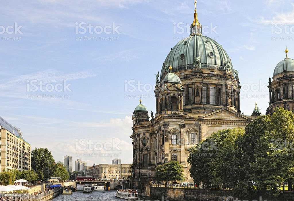 Berlin Cathedral with tourist boat passing by (Germany) stock photo