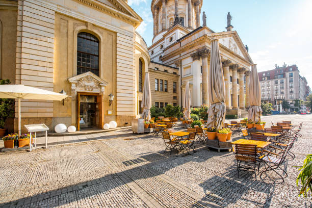 Berlin city view Viiew on the Gendarmenmarkt square near French cathedral with cafe during the morning light in Berlin city gendarmenmarkt stock pictures, royalty-free photos & images