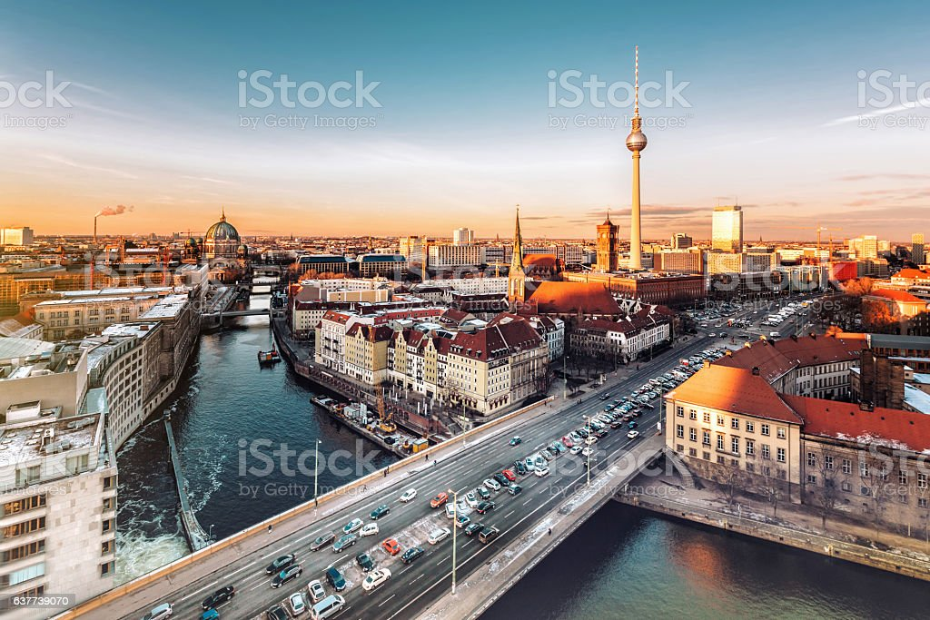berlin cityscape with television tower under at sunset hour – Foto