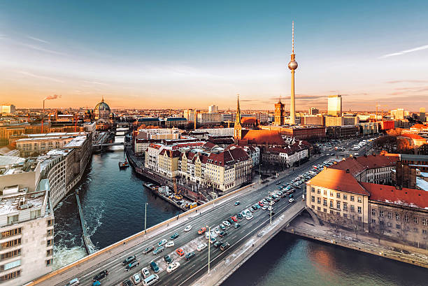 berlin cityscape with television tower under at sunset hour stock photo