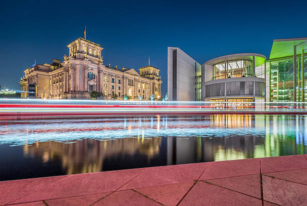 berlin government district with reichstag and spree river at night - cupola stock pictures, royalty-free photos & images