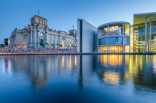 Berlin government district with Reichstag and Spree river in twilight, central Berlin Mitte, Germany