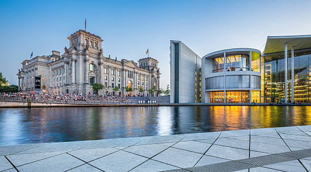 Berlin government district with Reichstag building at dusk Panoramic view of Regierungsviertel (government district) with famous Reichstag building and Paul Lobe Haus (Deutscher Bundestag) at dusk, Berlin, Germany. berlin stock pictures, royalty-free photos & images