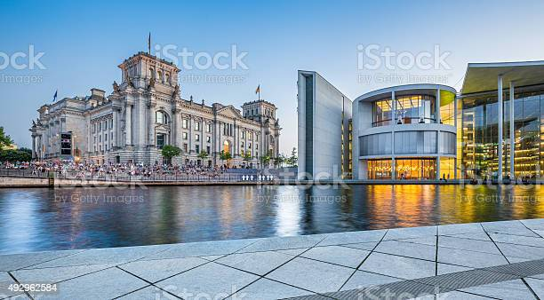 Photo of Berlin government district with Reichstag building at dusk