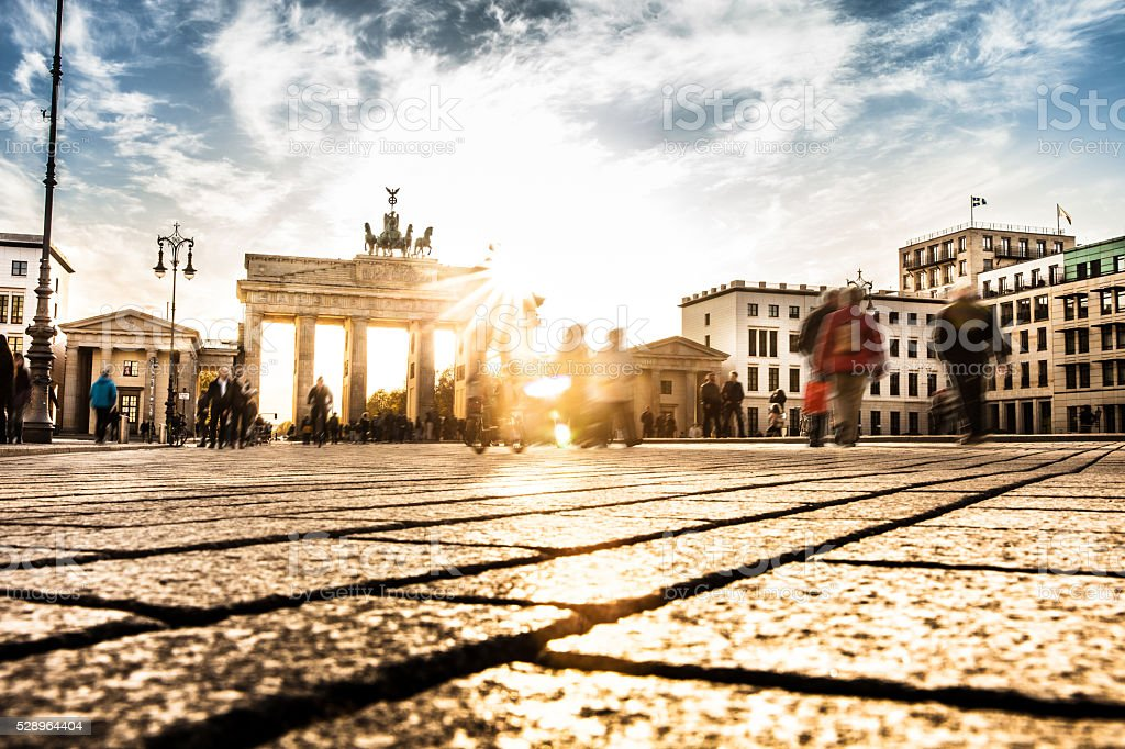 Berlin - People cycling at Brandenburg Gate stock photo