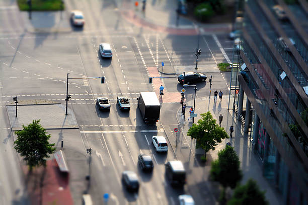 Berlin  traffic at a crossroads in the middle of downtown Berlin road intersection stock pictures, royalty-free photos & images