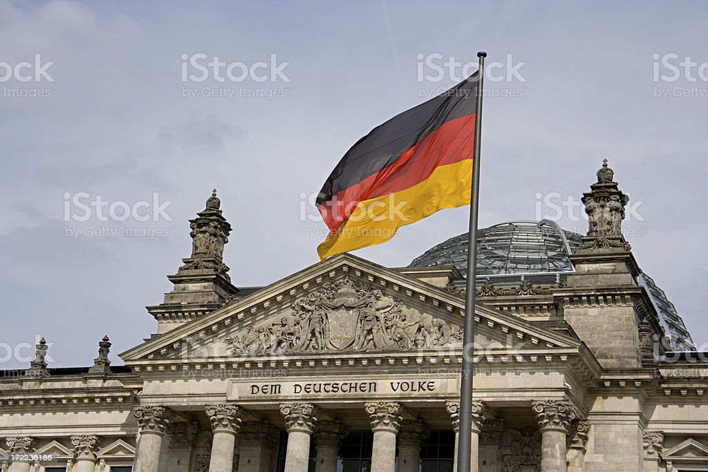 Berlin Reichstag And German Flag royalty-free stock photo
