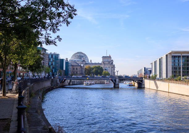 Berlin Reichstag and ship on Spree river stock photo