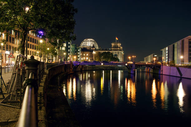 Berlin Reichstag and Spree river at night stock photo