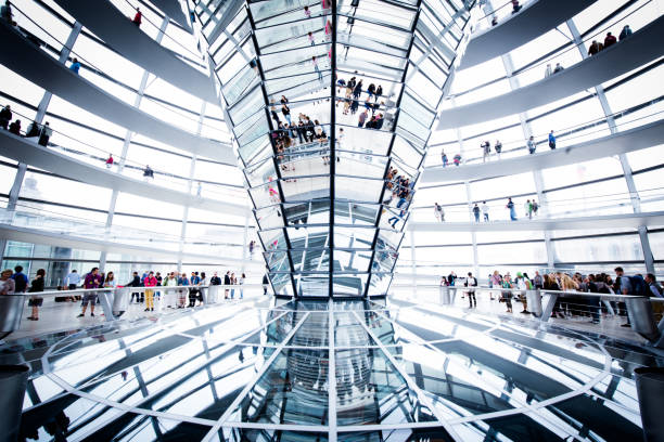 Berlin Reichstag Dome, Germany BERLIN - JULY 19, 2015: Interior view of famous Reichstag Dome in Berlin, Germany. Constructed to symbolize the reunification of Germany it's now one of Berlin's most important landmarks. cupola stock pictures, royalty-free photos & images