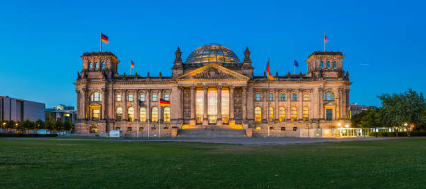 Berlin Reichstag German Parliament illuminated at dusk panorama Germany stock photo