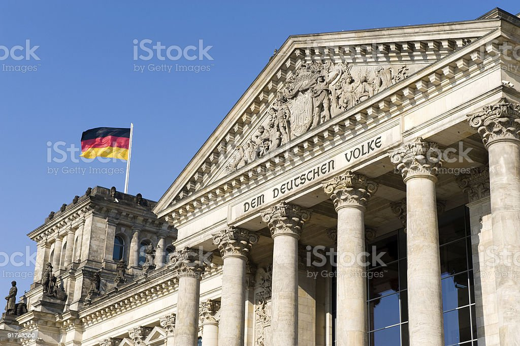 Berlin Reichstag with german flags stock photo