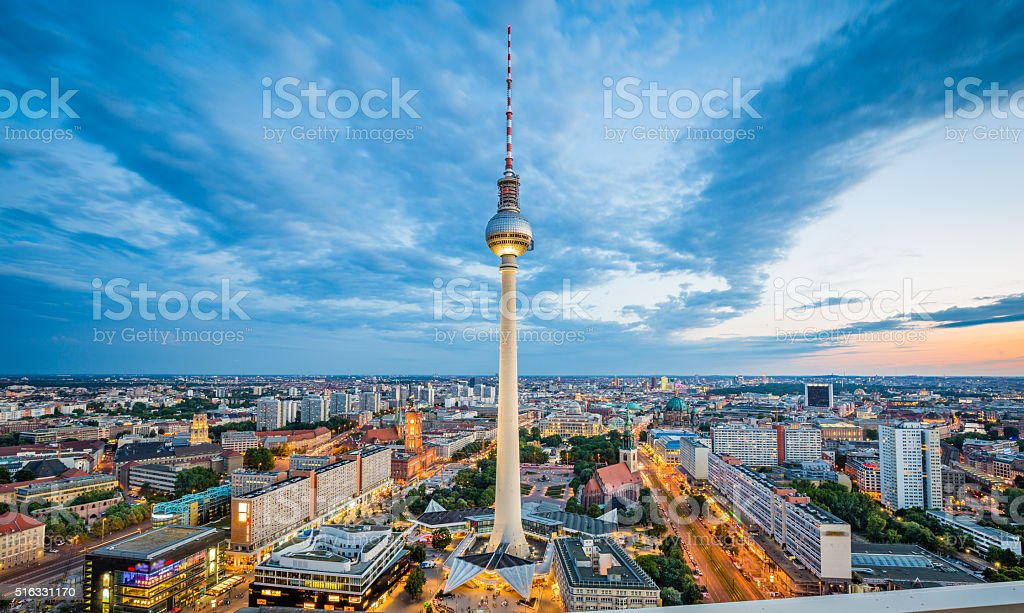 Berlin skyline panorama with TV tower at night, Germany Aerial view of Berlin skyline with famous TV tower at Alexanderplatz and dramatic cloudscape in twilight during blue hour at dusk, Germany. Aerial View Stock Photo