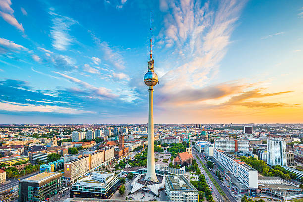 Berlin skyline panorama with TV tower at sunset, Germany Berlin skyline panorama with famous TV tower at Alexanderplatz and dramatic cloudscape at sunset, Germany. berlin stock pictures, royalty-free photos & images
