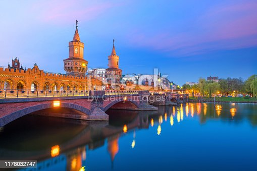 Berlin skyline with Oberbaum Bridge and Spree River, at sunrise, Germany