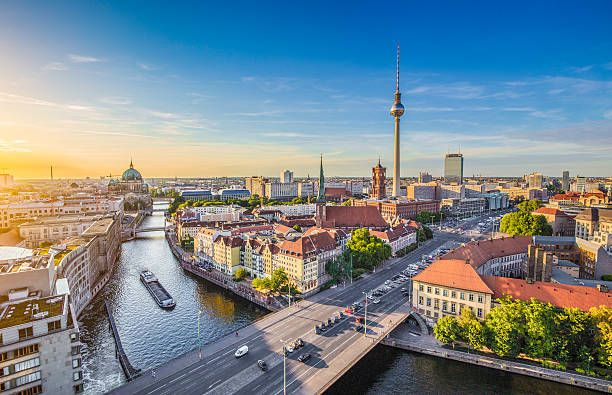 Berlin skyline with Spree river at sunset, Germany Aerial view of Berlin skyline with famous TV tower and Spree river in beautiful evening light at sunset, Germany. berlin stock pictures, royalty-free photos & images