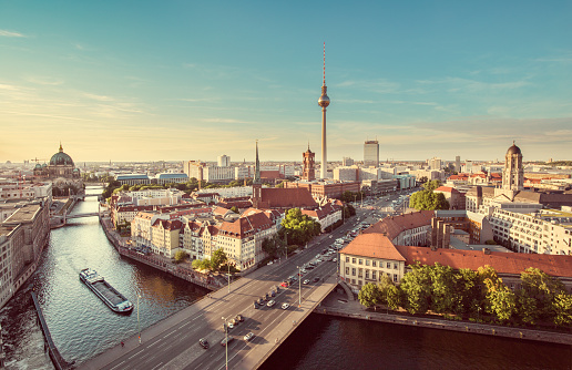 Aerial view of Berlin skyline with famous TV tower and Spree river in beautiful evening light at sunset with retro vintage Instagram style grunge pastel toned filter effect, Germany.