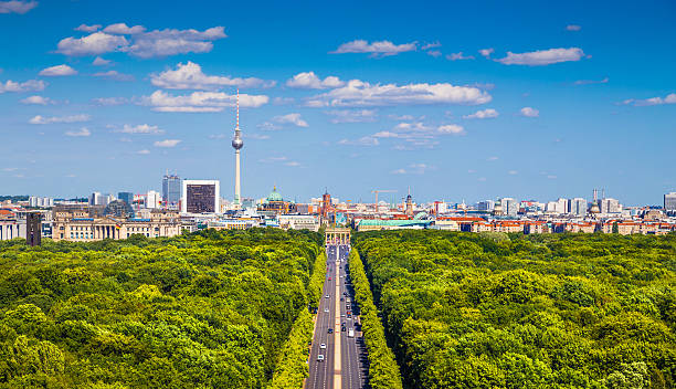 Berlin skyline with Tiergarten park in summer, Germany Aerial view of Berlin skyline panorama with Grosser Tiergarten public park on a sunny day with blue sky and clouds in summer, Germany. berlin stock pictures, royalty-free photos & images