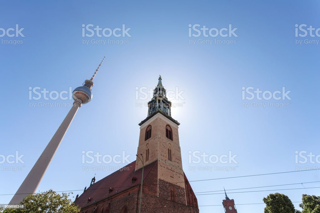 Berlin, St. Mary's Church and Television Tower, under a sunny, blue sky stock photo