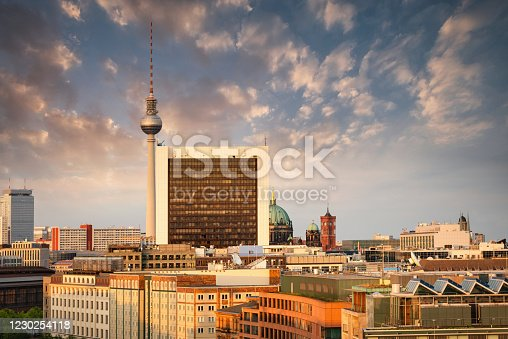 Berlin Mitte Cityscape under moody Sunset Twilight. View from above towards Berlin TV Tower at Alexanderplatz, Urban Rooftops, Berlin Cathedral and Berlin Townhall on the urban horizon. Berlin Mitte, Berlin, Germany.