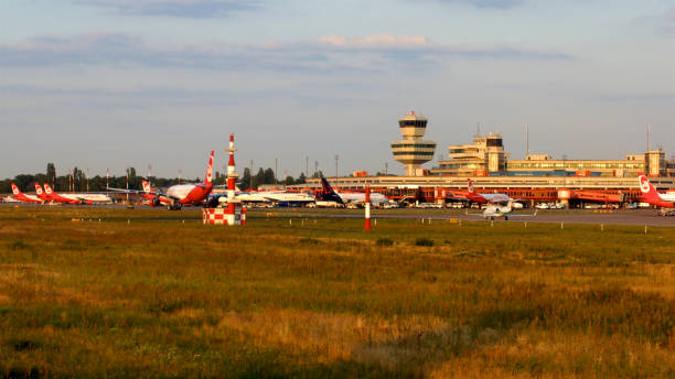 Berlin Tegel Otto Lilienthal Airport TXL control tower and main terminal building during sunset stock photo