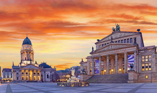 Berlin - The Deutscher Dom church and The Konzerthaus building in Gendarmenmarkt square at dusk. BERLIN, GERMANY, FEBRUARY - 13, 2017: The Deutscher Dom church and The Konzerthaus building in Gendarmenmarkt square at dusk. gendarmenmarkt stock pictures, royalty-free photos & images