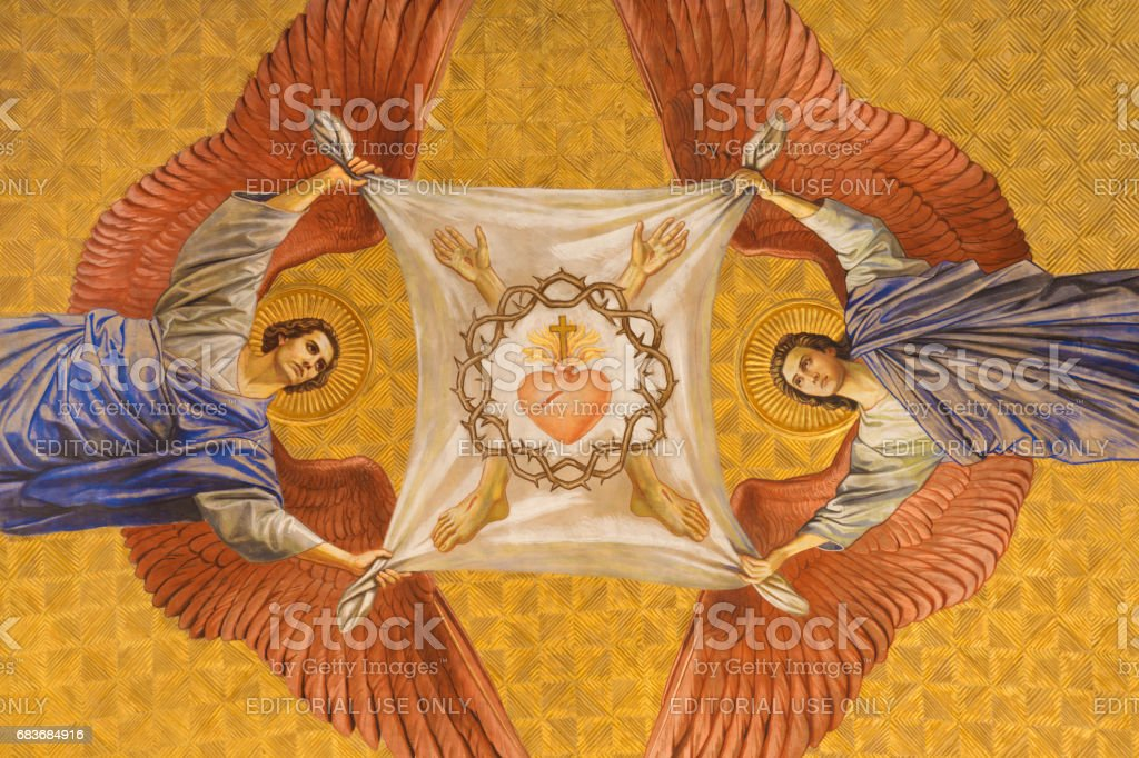 Berlin - The fresco of anges with the crown of thorns and heart of Jesus in Herz Jesus church by Friedrich Stummel and Karl Wenzel from end of 19. and begin of 20. cent. - foto stock