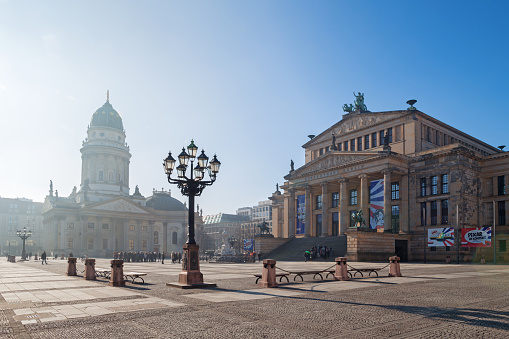Berlin - The Konzerthaus building and the memorial of Friedrich Schiller and German dom on the Gendarmenmarkt square.