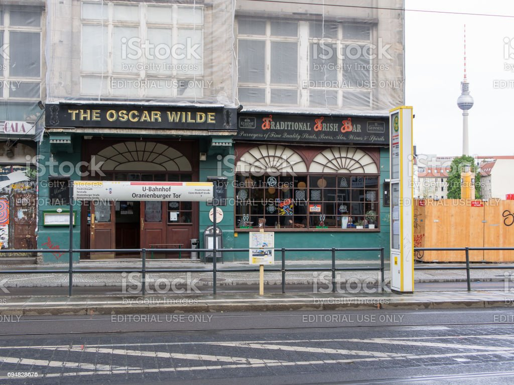 Berlin: The Oscar Wilde, Traditional Irish Bar With TV Tower in Background stock photo