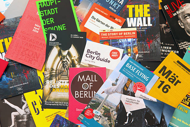 Berlin tourist flyers, leaflets and advertisements to local events stock photo
