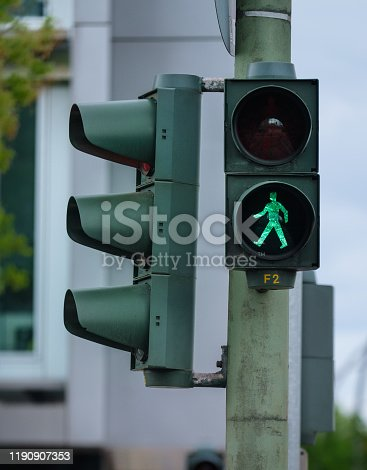 The walking figure in the traffic light is an icon special to Berlin.